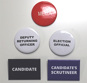 Multi Buy Value Pack of 20 badges to choose from include Media, Deputy Returning Officer, Election Official, Candidate, and Candidate's Scrutineer